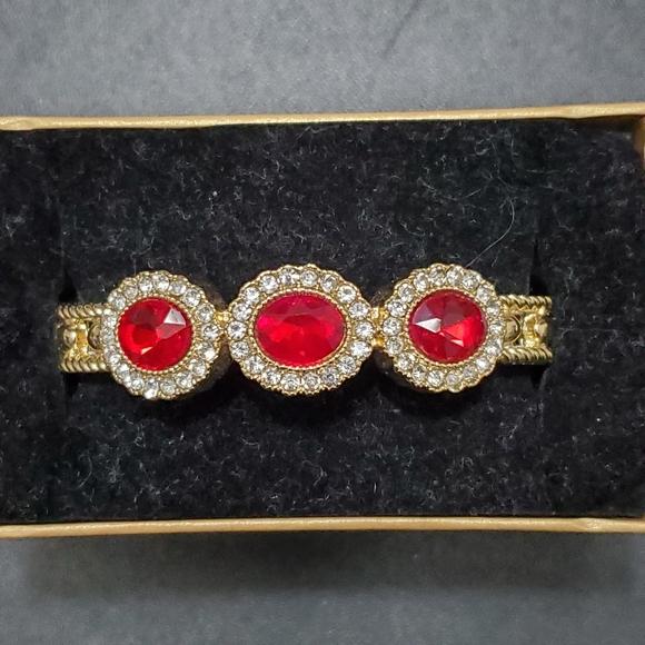 Monet gold tone red rhinestone bracelet